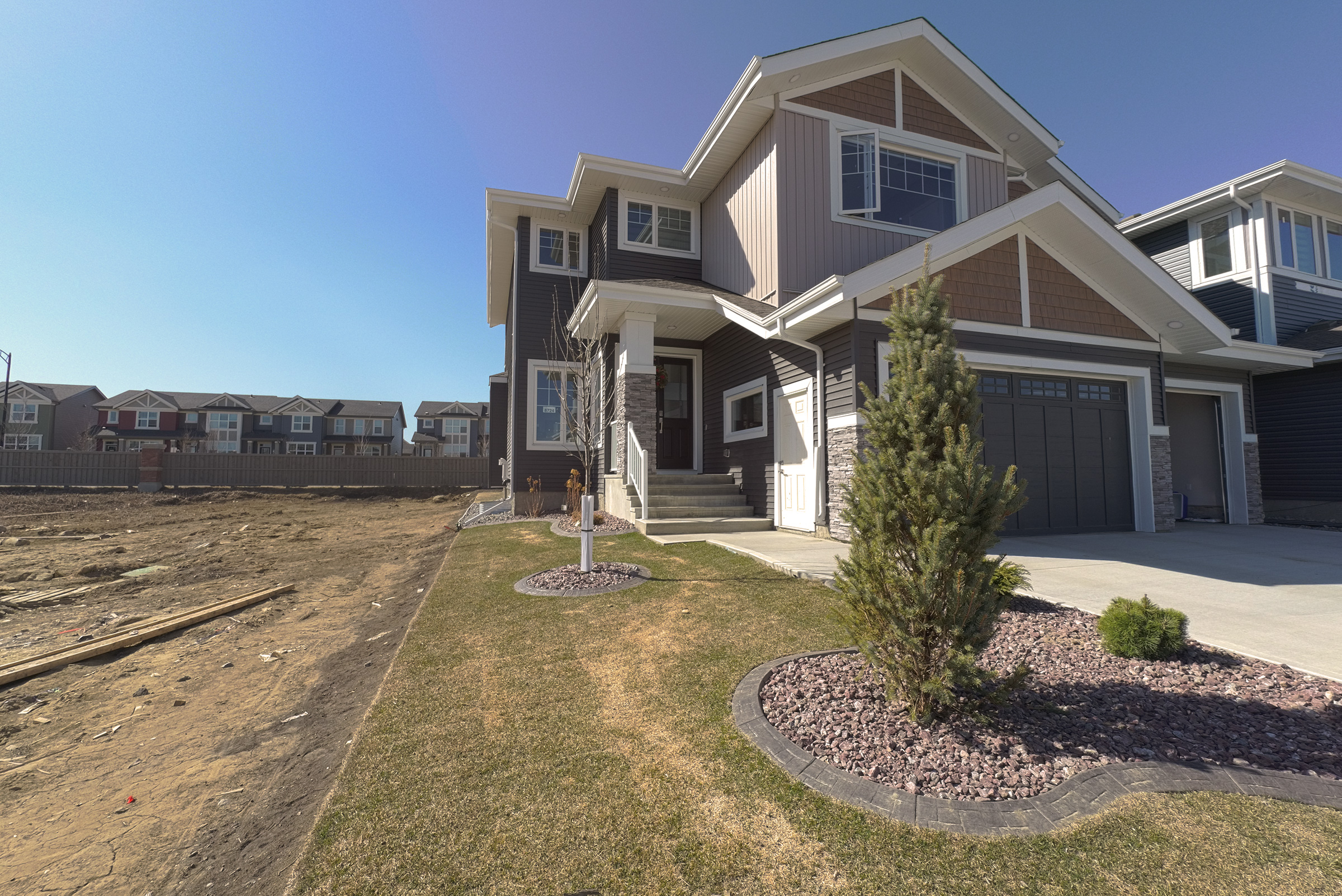 2 story Rosenthal 3080 sqft. triple garage at the front